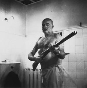 Ernest Hemingway with shotgun